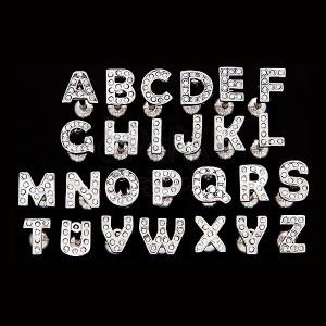 Piercing do jazyka z oceli - písmeno se zirkony