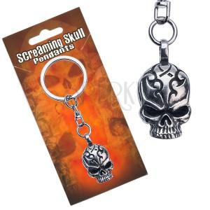 Přívěsek na klíče kovový, lebka s vyrytými ornamenty