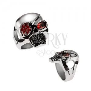 Masivní ocelový prsten, lebka s páskou přes oko, červené zirkony