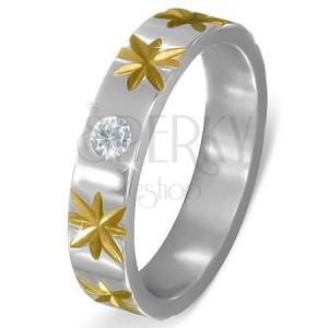 Stříbrný ocelový prsten se zlatými hvězdami a čirým zirkonem