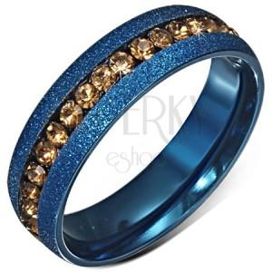 Modrá anodizovaná obroučka s pískovaným povrchem, žutý zirkonový pás