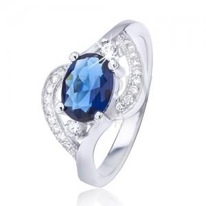 Stříbrný prsten 925 s oválným modrým zirkonem, zvlněná ramena