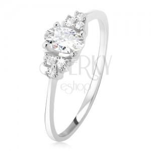 Prsten z bílého 14K zlata - oválný čirý zirkon, drobné kamínky na bocích