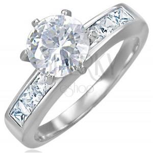Snubní ocelový prsten s vystupujícím středovým zirkonem