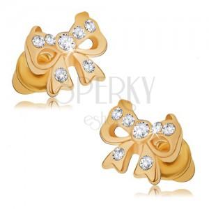 Lesklé puzetové náušnice zlaté barvy, mašle s kamínky