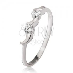 Stříbrný prsten 925 - nepravidelné měsíčky, dva kulaté čiré zirkony
