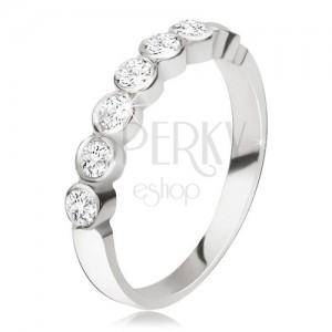 Stříbrný prsten 925 - pás kulatých čirých zirkonů v lesklých objímkách