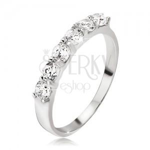 Prsten ze stříbra 925, pás kulatých čirých zirkonů v kalíšcích