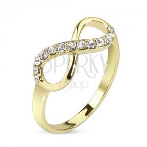 Prsten zlaté barvy, symbol nekonečna zdobený čirými zirkony