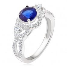 Stříbrný prsten, tmavomodrý kámen, oblé zirkonové linie