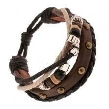 Náramok - hnedý vybíjaný pás, pletenec, šnúrky, korálky z dreva a kovu