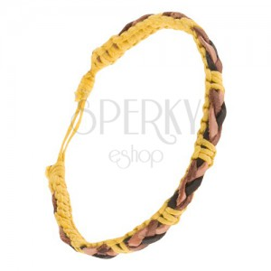 Žlutý šňůrkový náramek, hnědo-černý kožený copánek na povrchu