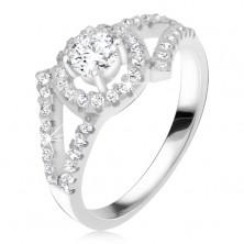 Strieborný 925 prsteň, rozvetvené ramená, okrúhly kameň s lemom