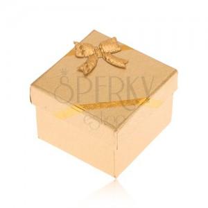 Dárková krabička na prsten, povrch zlaté barvy, mašle