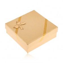Dárková krabička zlaté barvy na šperky, vzhled tkaniny, mašle