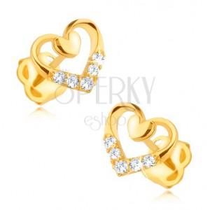 Zlaté náušnice 375 - pravidelný obrys srdce s menším plným, zirkony