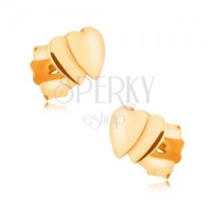Náušnice ve žlutém 9K zlatě - dvě malá překrývající se souměrná srdíčka