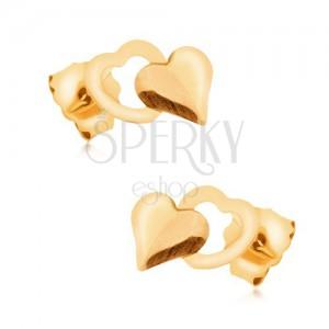 Zlaté náušnice 375 - lesklé pravidelné plné srdce překrývající obrys srdíčka