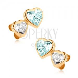 Zlaté náušnice 375, malé zirkonové srdce a větší srdce z modrého topasu