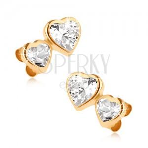 Zlaté puzetové náušnice 375, menší a větší zirkonové srdce