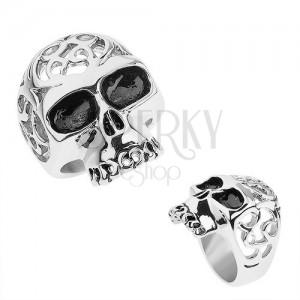 Ocelový prsten stříbrné barvy, lebka s ozdobnými výřezy
