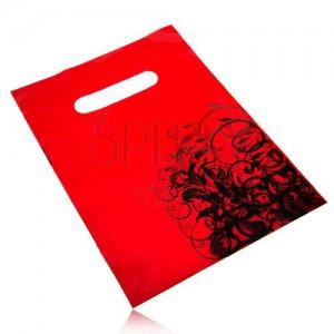 Igelitová ozdobná taštička červené barvy, černé květinové ornamenty
