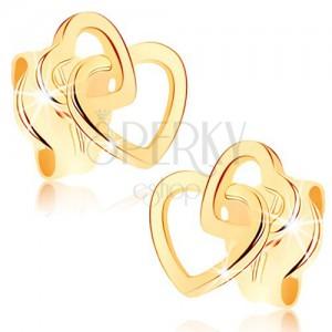 Náušnice ve žlutém 9K zlatě - propojené obrysy dvou symetrických srdíček