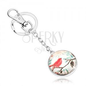 Cabochon klíčenka, kruh se sklem, červený ptáček na větvi s lístky, květy