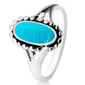 Stříbrný prsten 925, ovál z tyrkysu, kontura z kuliček, rozdělená ramena