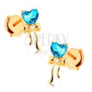 Zlaté náušnice 585 - lesklá mašlička, modré topasové srdíčko