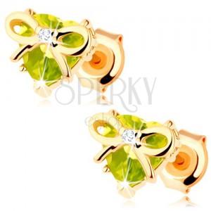 Náušnice ve žlutém 9K zlatě - srdce ze zeleného olivínu zdobené tenkou mašličkou