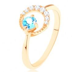 Zlatý prsten 585 - srpek měsíce zdobený čirými zirkonky, modrý topas