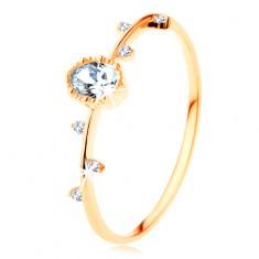 Prsten ze žlutého 14K zlata - čirý ovál s vroubkovaným okrajem, drobné zirkonky