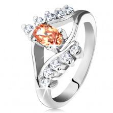 Prsten ve stříbrné barvě s rozdělenými rameny, oranžový ovál, čiré linie zirkonů
