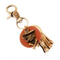 Přívěsek na klíče v mosazném odstínu, hnědý kruh, lebka v klobouku