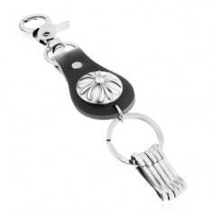 Patinovaný přívěsek na klíče v tmavě šedém odstínu, liliový kříž v kruhu
