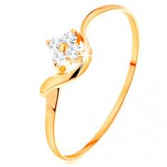 Prsten ze žlutého 14K zlata - čirý zirkonový kvítek, zvlněné rameno