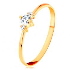 Prsten ze žlutého 14K zlata se zúženými rameny, tři blýskavé čiré zirkony GG156.50/56