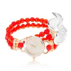 Analogové hodinky, korálkový červený náramek, ciferník se zirkony, bílý květ
