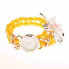 Hodinky z průhledných žlutých korálků, ciferník se zirkony, velký květ