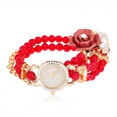 Analogové hodinky, korálkový červený náramek, ciferník se zirkony, růže