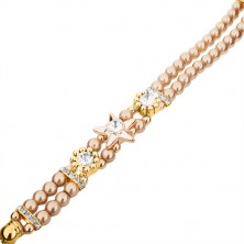 Náramkové hodinky, ciferník se zirkony, náramek z korálků zlaté barvy, květy