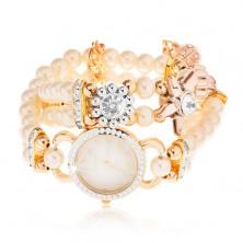 Analogové hodinky, ciferník se zirkony, náramek z bílých korálků, květy