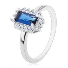 Rhodiovaný prsten, stříbro 925, obdélníkový modrý zirkon, čirý zirkonový lem J15.18