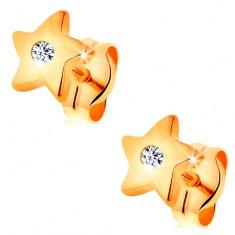 Náušnice ve žlutém 14K zlatě - lesklé hvězdičky s čirým zirkonem uprostřed