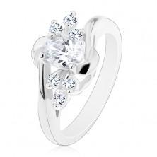 Lesklý prsten se zahnutými rameny, čirý ovál, blýskavé čiré zirkonky, obloučky