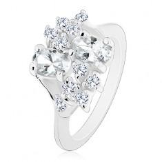 Prsten stříbrné barvy se zúženými rameny, čiré oválné a kulaté zirkonky