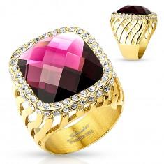 Mohutný ocelový prsten zlaté barvy, velký fialový zirkon s čirou obrubou, výřezy