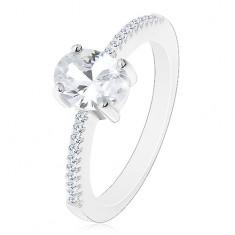 Stříbrný prsten 925, oválný zirkon čiré barvy v kotlíku, zirkonky na ramenech