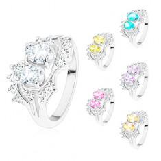 Prsten stříbrné barvy, zahnuté konce ramen, blýskavé čiré a barevné zirkony